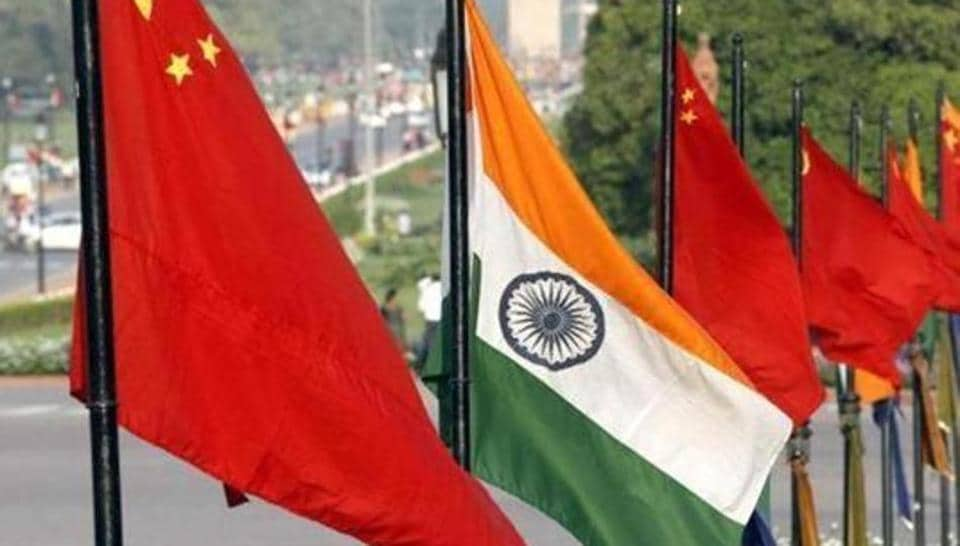 The national flags of India and China at Vijay Chowk, Rajpath, in New Delhi.