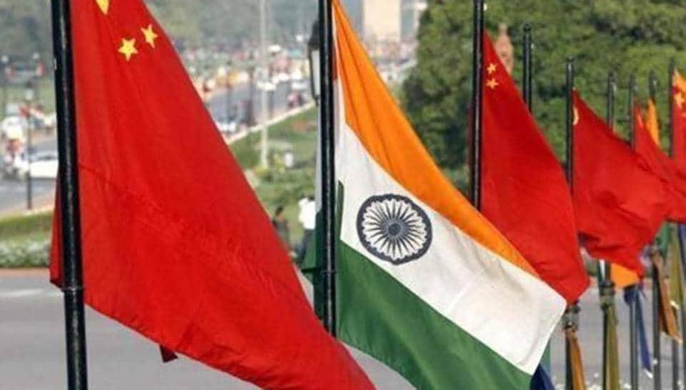 The national flags of India and China at Vijay Chowk, Rajpath, in New Delhi.