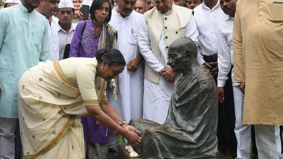 Opposition candidate Meira Kumar pays respects at a statue of Mahatma Gandhi during her visit to the Sabarmati ashram in Ahmedabad.