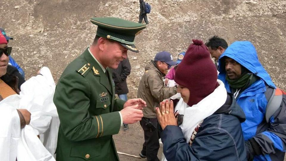 A Chinese army officials greets first batch of Kailash Mansarovar pilgrims from India at Taklakot, also known as Burang City in China.