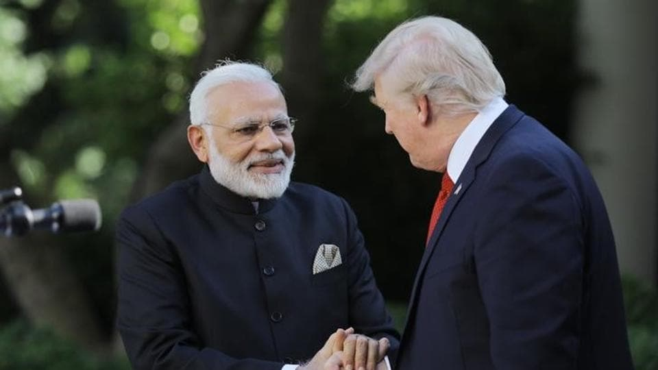 U.S. President Donald Trump (R) greets Prime Minister Narendra Modi during their joint news conference in the Rose Garden of the White House in Washington, June 26