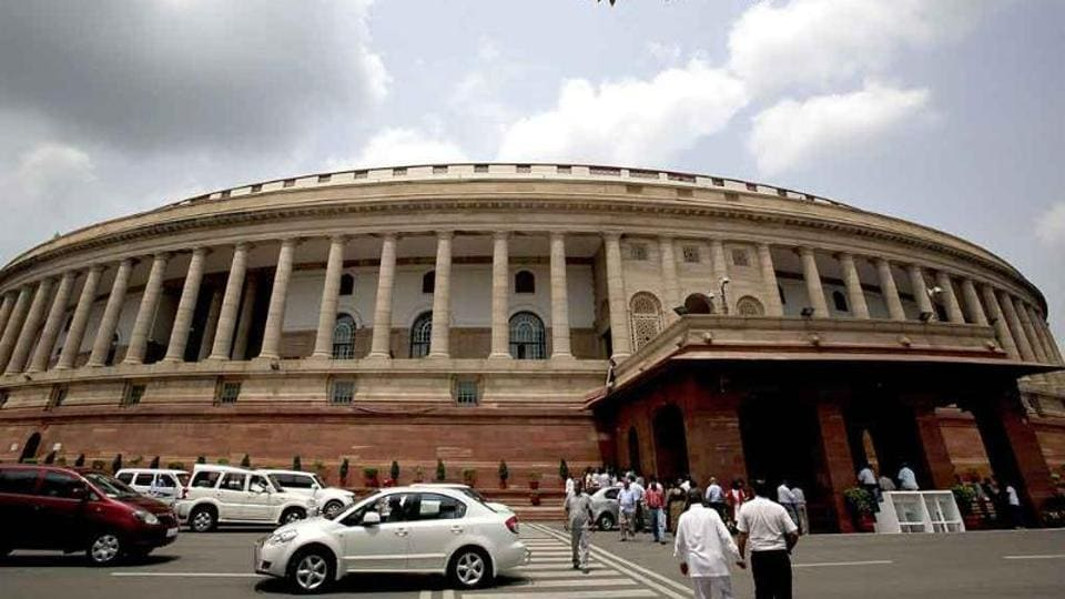 Traffic flows in front of Parliament House before the start of monsoon session in New Delhi.