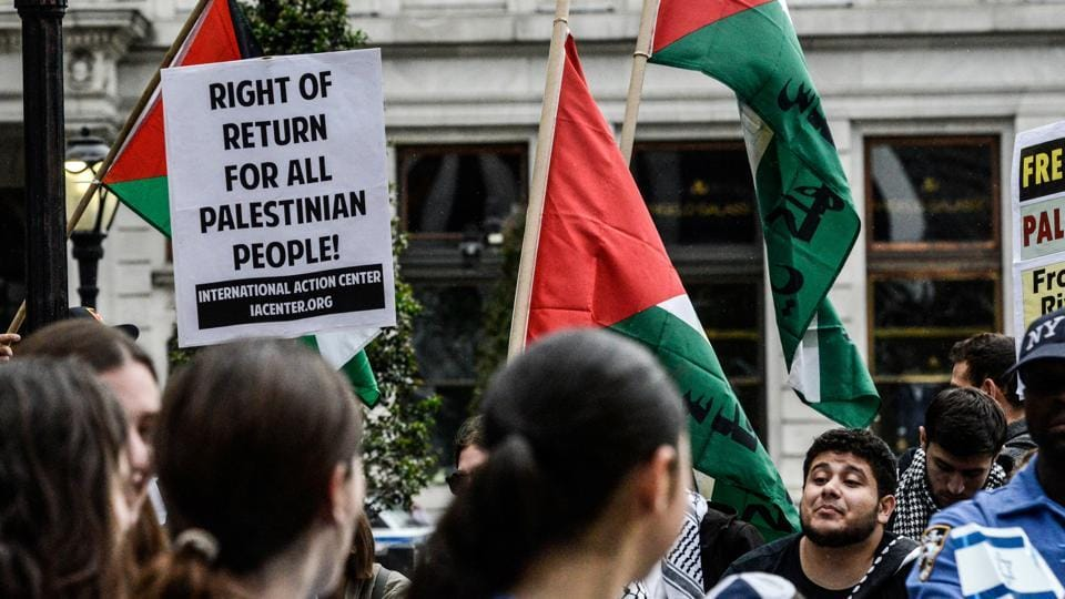 People protesting for Palestinian rights attend the 'Celebrate Israel' parade, New York City, June 4. Criticism of America's unflinching support of Israel is more palpable than before