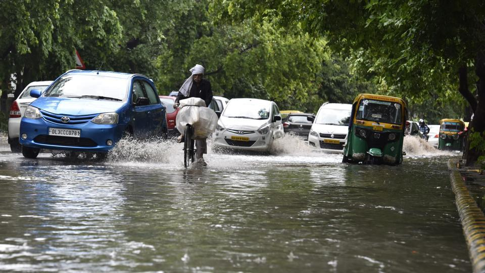 Vehicles pass through a waterlogged road in Gurgaon. Monsoon to hit Delhi by July 4.