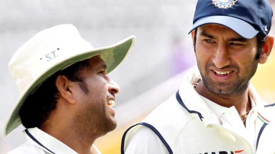Sachin Tendulkar and Cheteshwar Pujara share a light moment during the cricketing great's playing days.