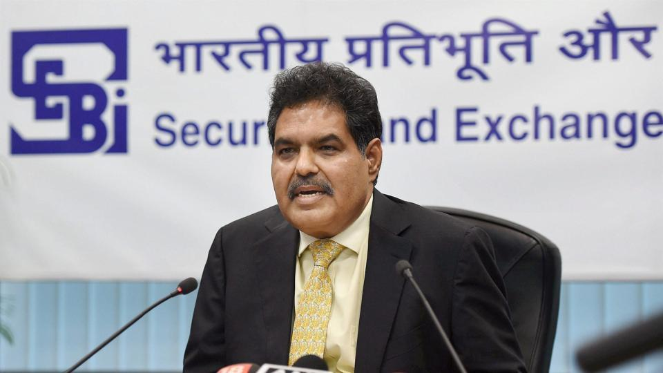 Securities and Exchange Board of India chairman Ajay Tyagi speaks during a press conference in Mumbai.