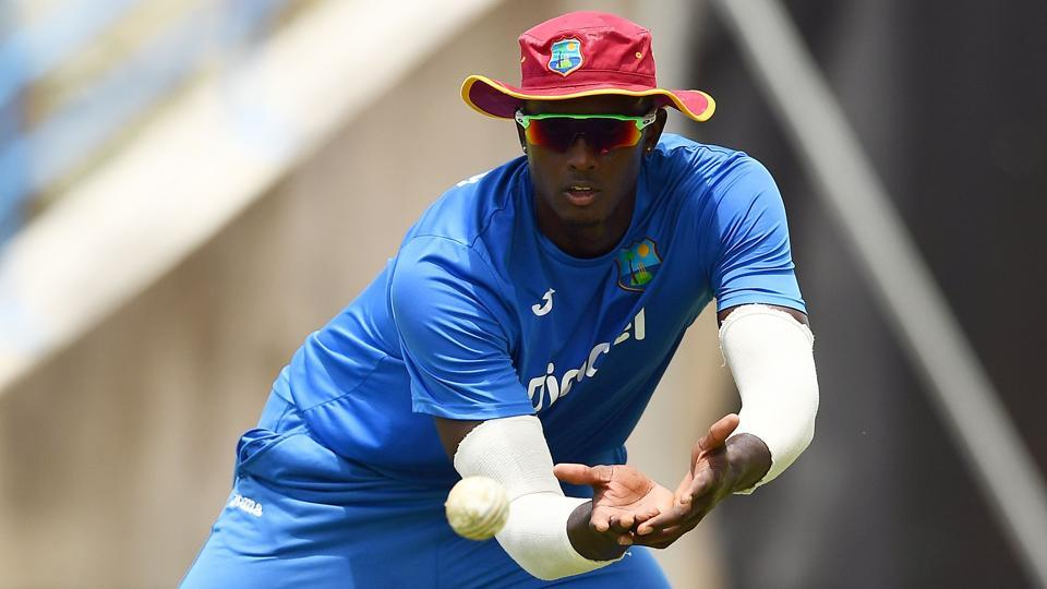 West Indies' captain Jason Holder catches a ball during a practice session at the Sir Vivian Richards Cricket Ground in St. John's, Antigua.
