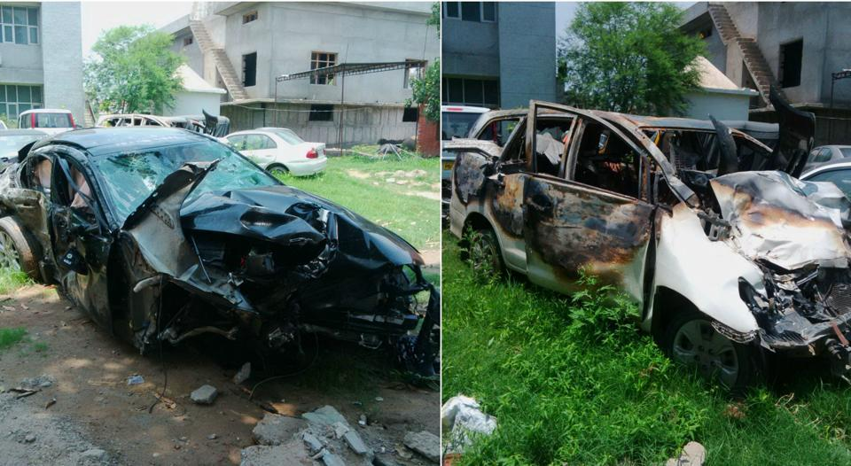 Jaguar car (left) and a Toyota Innova collided on the railway crossing flyover at Dhakoli on the Zirakpur-Kalka highway on Saturday.
