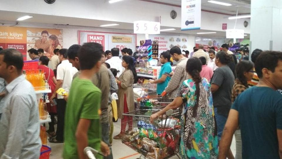 People stock up on groceries at a store in Mumbai during a midnight sale on June 30, shortly after the government rolled out the GST.