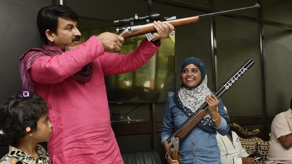 Delhi BJP president Manoj Tiwari  seen with national level shooter Ayisha Falaq at his residence in New Delhi.  Ayisha fired her licensed .32 bore pistol at the kidnappers in self-defence and saved a relative's life. (Vipin Kumar / HT Photo)