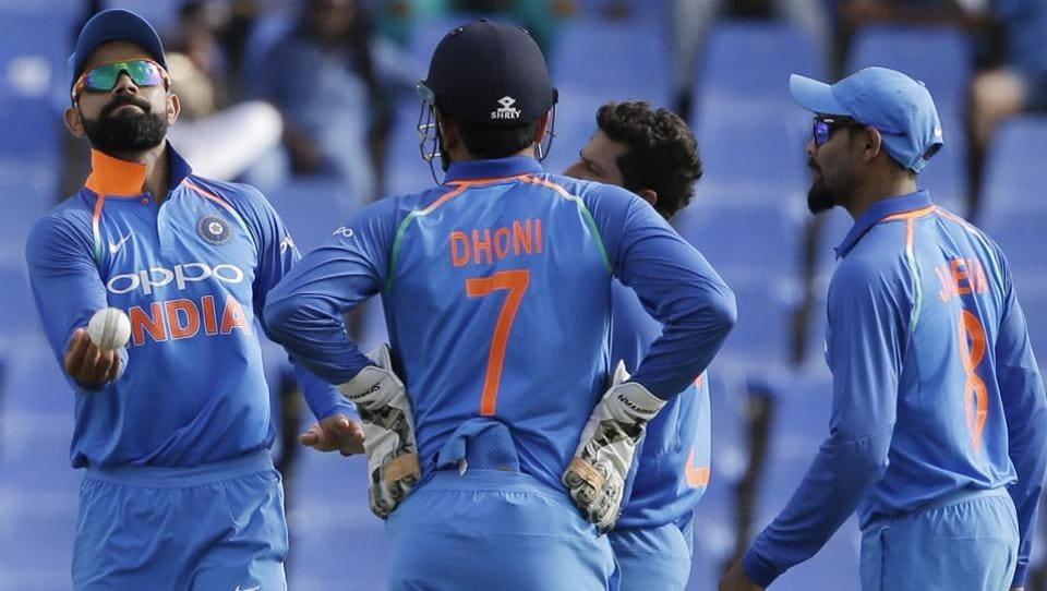 India's captain Virat Kohli, left, and teammates celebrate the dismissal of West Indies' Miguel Cummins during their third ODI cricket match at the Sir Vivian Richards Stadium in North Sound, Antigua.
