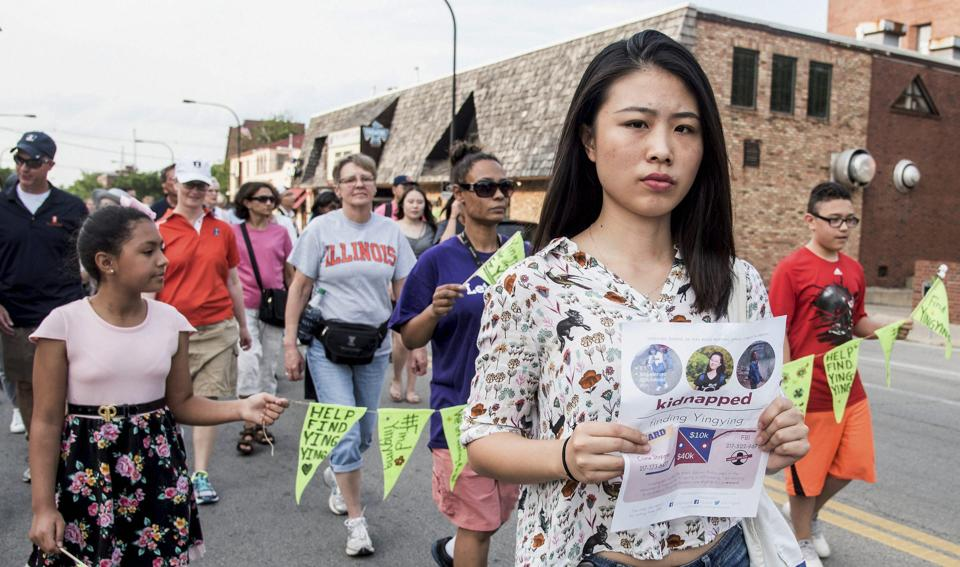 Fangqin Wan, a graduate student at the University of Illinois, walks for Yingying Zhang, a Chinese scholar who went missing three weeks ago.