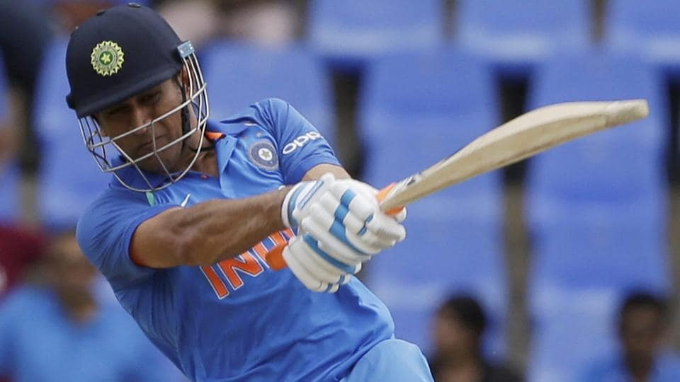 India's MS Dhoni plays a shot against West Indies during their third ODI cricket match at the Sir Vivian Richards Stadium.