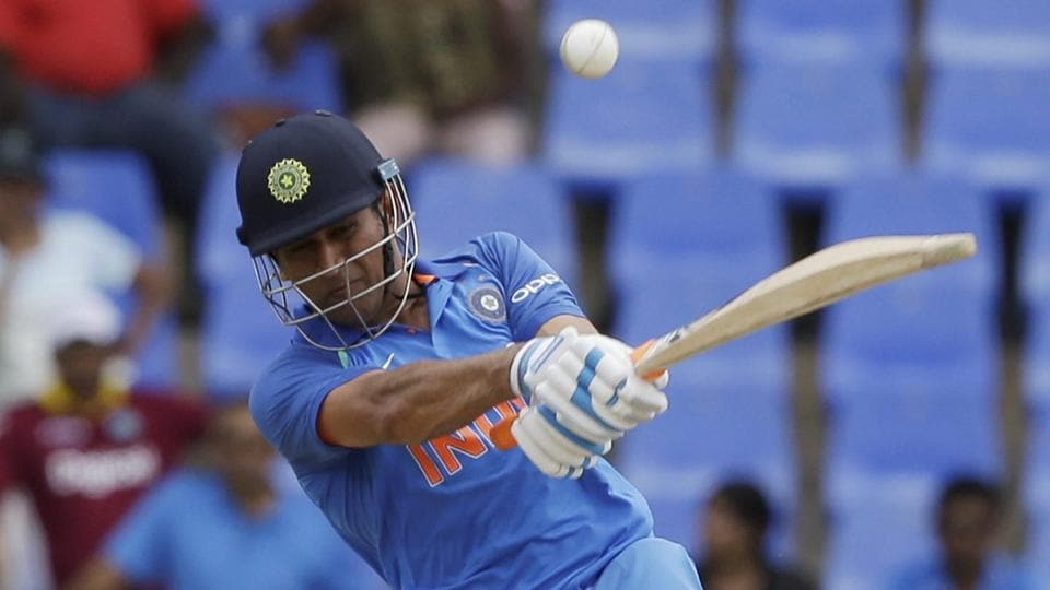 India's MS Dhoni plays a shot against West Indies captain Jason Holder during their third ODI at the Sir Vivian Richards Stadium in North Sound, Antigua and Barbuda, on Friday.