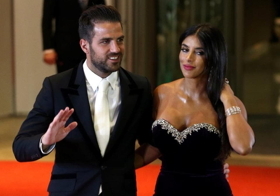 Lionel Messi's former Barcelona FC teammate Cesc Fabregas and his wife Daniella Semaan pose for photographers. (REUTERS)