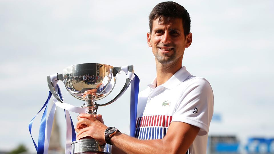 Serbia's Novak Djokovic celebrates with the trophy after winning the final against France's Gael Monfils at the Aegon International in Eastbourne on July 1.