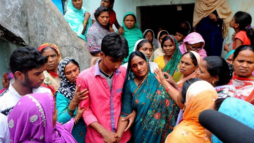 Mariyam Khatoon (centre in green saree), widow of Alimuddin who was lynched by a mob for carrying beef in Ramgarh, Jharkhand, on June 30.