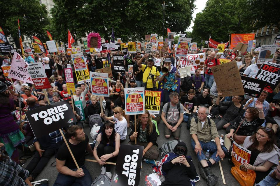 Protestors in front of 10, Downing Street during an anti-austerity demonstration on Saturday.