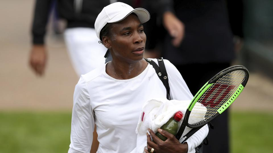Venus Williams makes her way to the practice courts during a preview day at the The All England Lawn Tennis and Croquet Club, London, on July 1.
