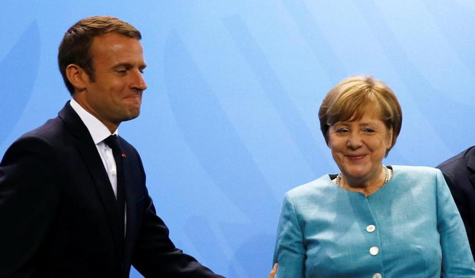 French President Emmanuel Macron and German Chancellor Angela Merkel attend the press conference after the meeting at the Chancellery in Berlin, Germany June 29, 2017.