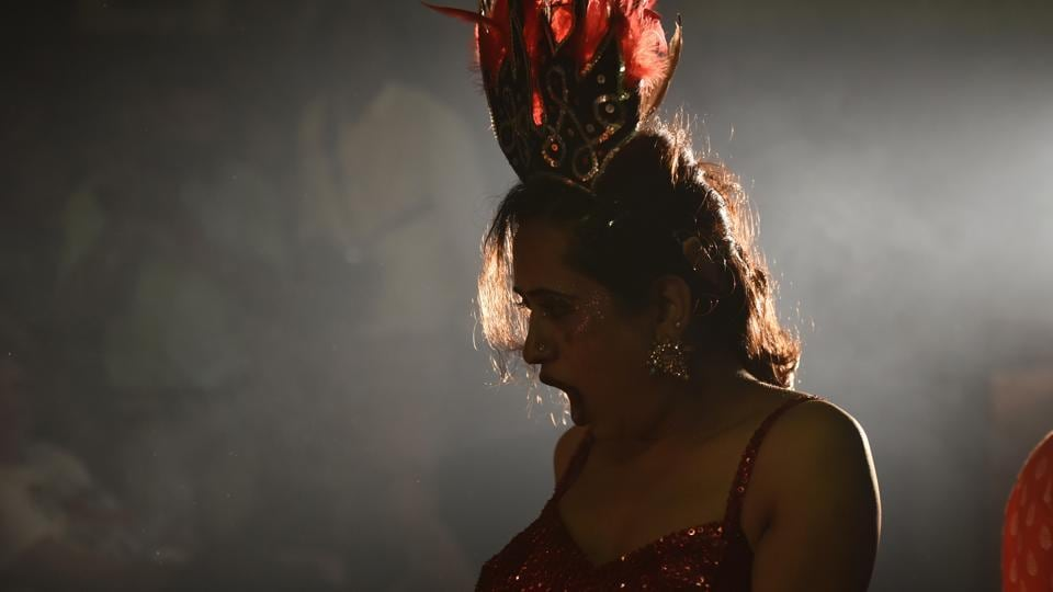 A member of Dancing Queens, a professional transgender-led troupe, during a performance at Parel in Mumbai on Saturday. (Anshuman Poyrekar/HT Photo)