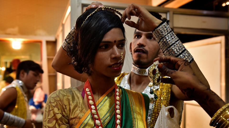 For more than 14 years, this group of 25 members have been promoting the welfare of transgenders through various events. Here, two dancers help each other get ready for a performance.  (Anshuman Poyrekar/HT Photo)