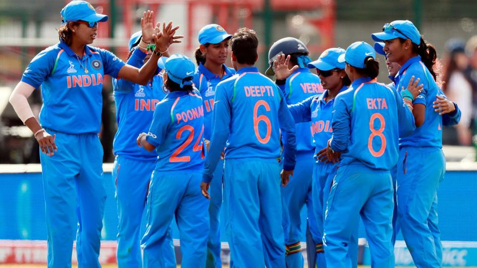 India celebrate after victory against England in the ICC Women's World Cup. They will face Pakistan on Sunday.