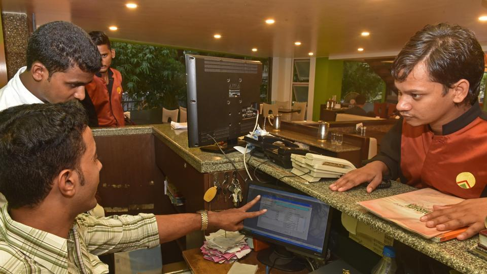 A hotel manager explains GST to his staff in Erandvane in Pune on Saturday.