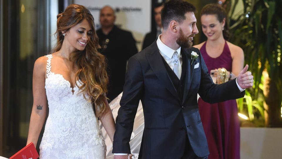 Argentine football star Lionel Messi and bride Antonella Roccuzzo pose for photographers just after their wedding. (AFP)