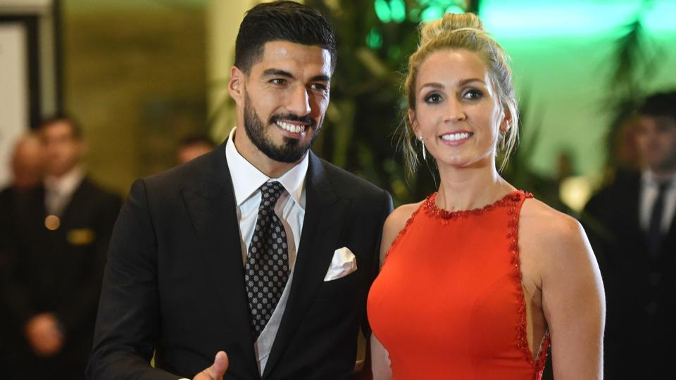 Uruguayan football player Luis Suarez and his wife Sofia Balbi pose on the red carpet. (AFP)