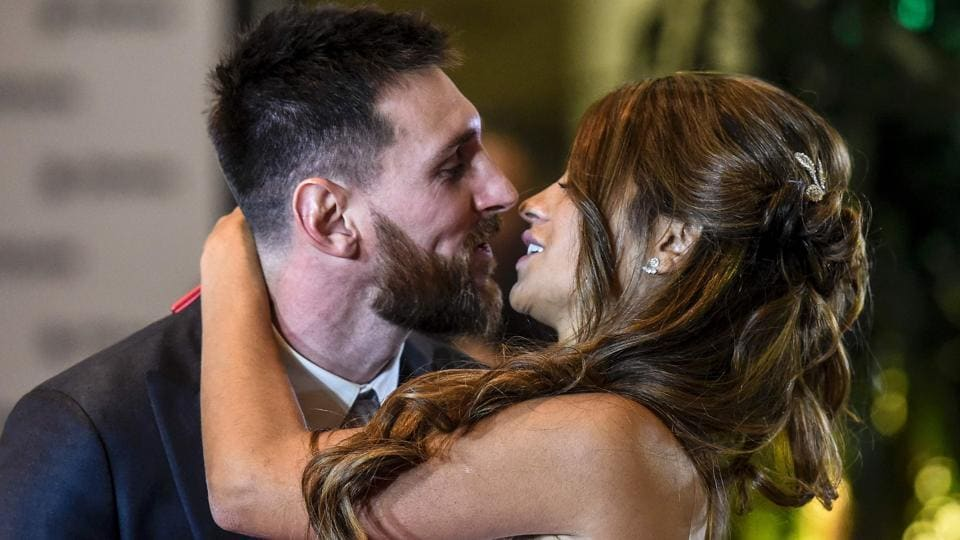 Argentine football star Lionel Messi and bride Antonella Roccuzzo pose for photographers during their wedding. (AFP)