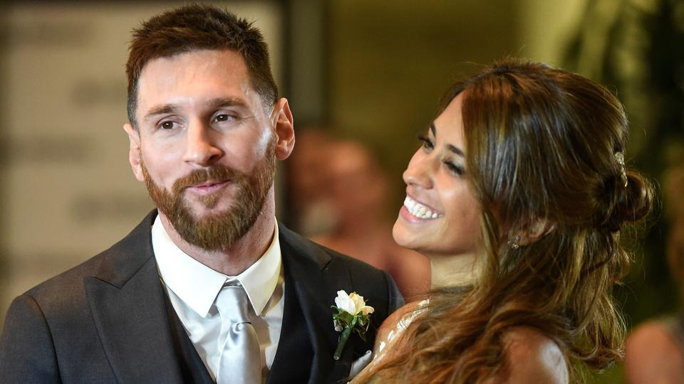 Lionel Messi and bride Antonella Roccuzzo pose for photographers just after their wedding.