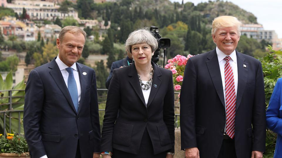 European Council President Donald Tusk, British Prime Minister Theresa May and U.S. President Donald Trump attend a flypast at San Domenico Palace Hotel on May 26, 2017 in Taormina , Italy.