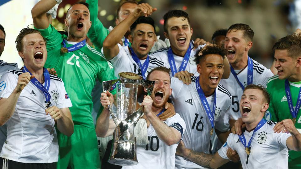 German football team players celebrate after winning the UEFA European Under-21 Championship title.