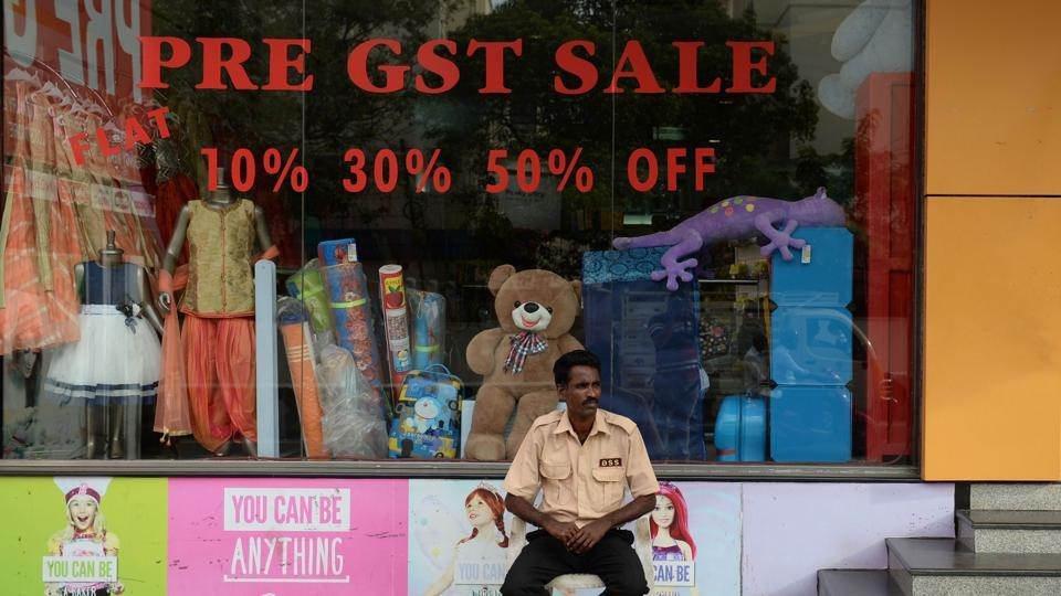 A security guard sits in shop giving discounts ahead of the Goods and Services Tax (GST) in Chennai, Tamil Nadu .  (Arun Sankar /AFP)