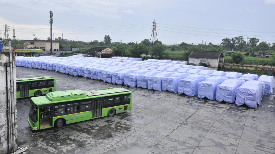 Buses covered with plastic covers to avoid damage during the a pre-monsoon shower at Indraprastha Bus Depot in New Delhi, India. (Arun Sharma / HT Photo)