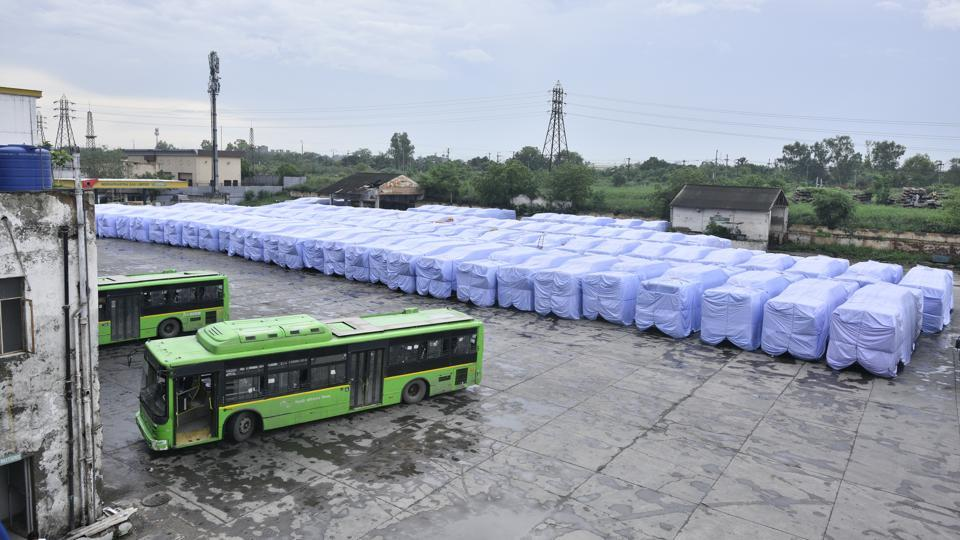 Old buses are being covered with waterproof materials like plastic and Rexine so that rainwater doesn't collect inside them