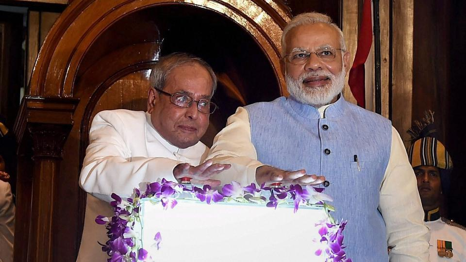 President Pranab Mukherjee and PM Narendra Modi press buttons for the launch of Goods and Services Tax (GST) at midnight, at the special ceremony in the Central Hall of Parliament in New Delhi.