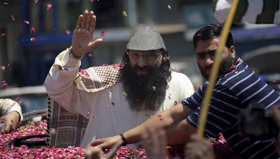 Hizbul Mujahideen chief Syed Salahuddin waves to his supporters as he arrives for a news conference in Muzaffarabad, the capital of Pakistan-occupied Kashmir.