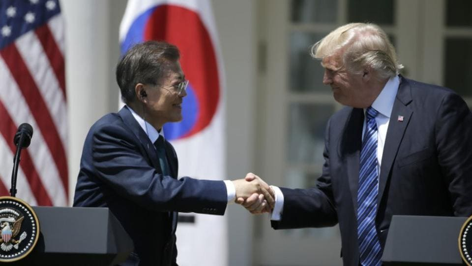 US President Donald Trump (R) greets South Korean President Moon Jae-in prior to delivering a joint statement from the Rose Garden of the White House in Washington, U.S., June 30, 2017.