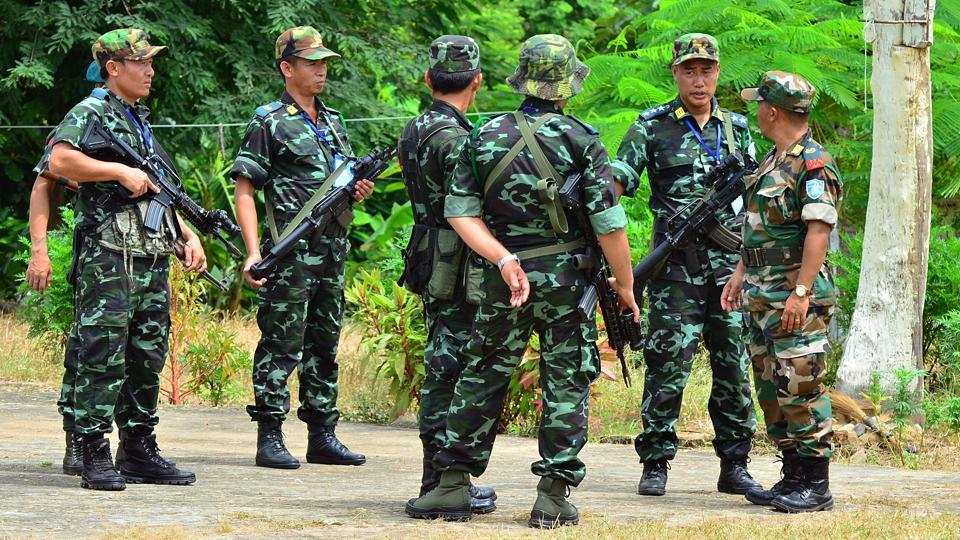 NSCN-IM rebels around their camp and the outfit's leader Thuingaleng Muivah with others.