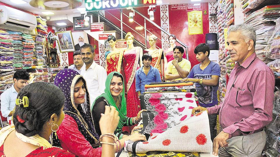 A large number of shops selling fabrics and branded clothes in Sadar Bazar offered almost 30% to 40% discount on their goods. The new tax to be imposed on the sector is yet to be decided, a seller said.