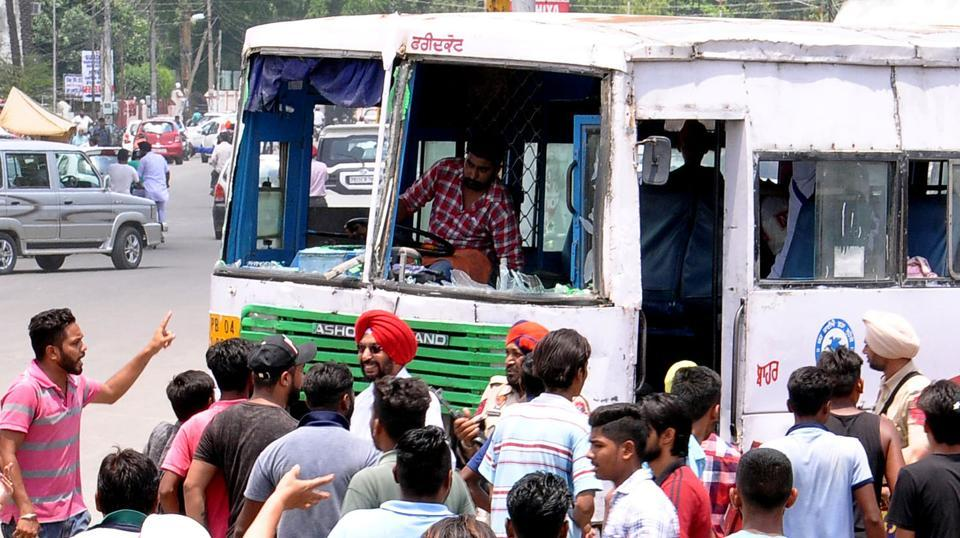 Family members of Paras, who was murdered in a clash , vandalised a PRTC bus at Fountain Chowk in Patiala on Saturday.