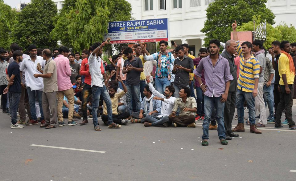Members of the  Rajput community block the road opposite the Rajput sabha bhawan in Jaipur, demanding a CBI inquiry into the death of  Anandpal , on Saturday.