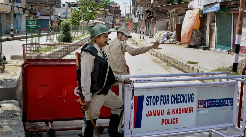 Security personnel at a check post during restrictions in downtown Srinagar on Friday.