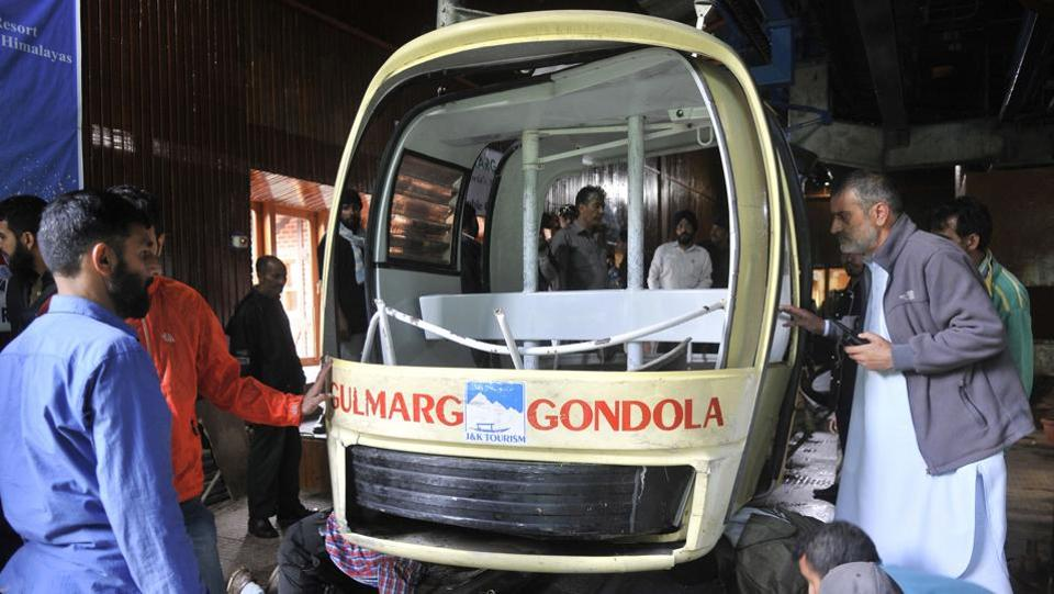 Officials check the damaged gondola in which four tourists, including two children as well as three locals died when a cable car came crashing down after being hit by an uprooted tree  after strong winds at Gulmarg tourist resort in Jammu & Kashmir. (Waseem Andrabi / HT Photo)