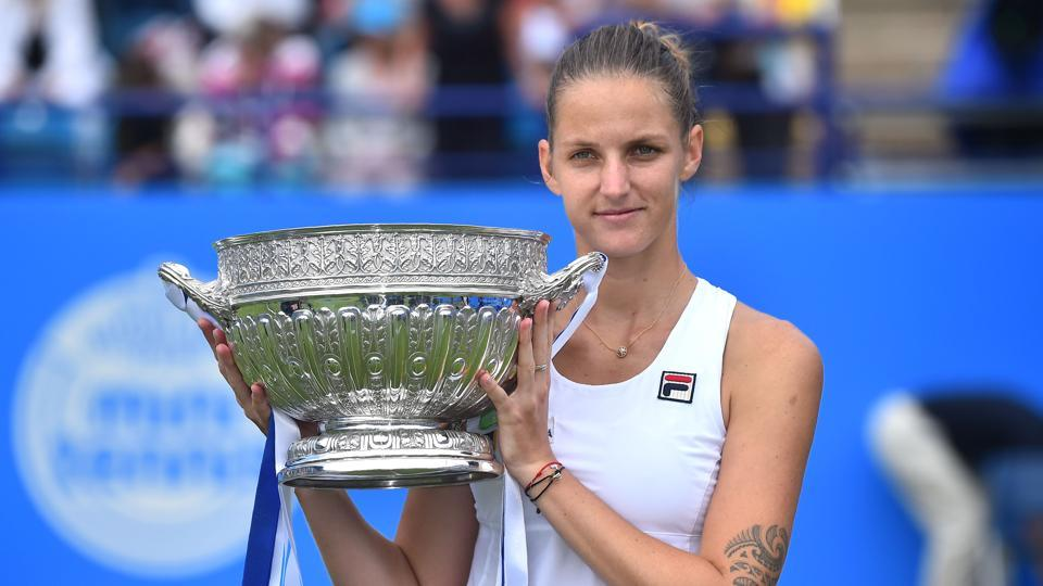 Czech Karolina Pliskova poses with the trophy after beating Denmark's Caroline Wozniacki in the women's singles final at the ATP Aegon International in Eastbourne on July 1.