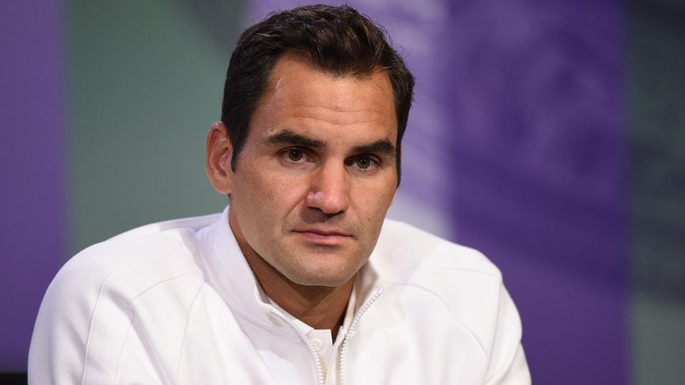 Switzerland's Roger Federer addresses a press conference at Wimbledon on July 1.