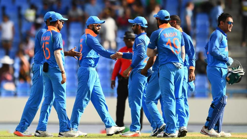 India captain Virat Kohli (C) celebrates with teammates after defeating West Indies at the end of the third ODI at the Sir Vivian Richards Cricket Ground in St. John's, Antigua.