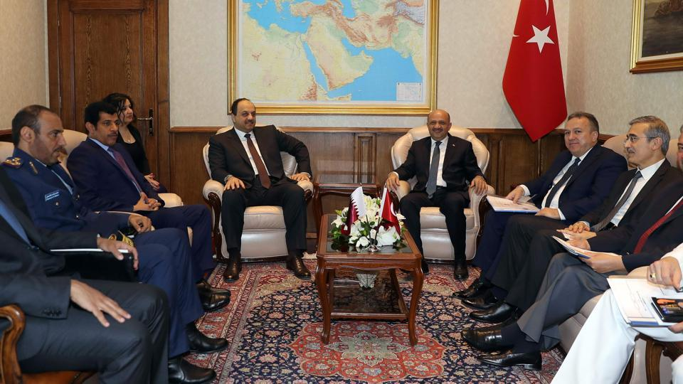 Turkey's defence minister Fikri Isik (right) and Qatar's counterpart Khalid bin Mohammed al-Attiyah (left) sitting together with delegations prior to their meeting in Ankara.